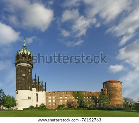 Castle and the Castle Church of Luther City Wittenberg in Germany. It is told in 1517 Martin Luther posted his 95 zheses on zhe door of the main entrance. UNESCO World Heritage Site - stock photo
