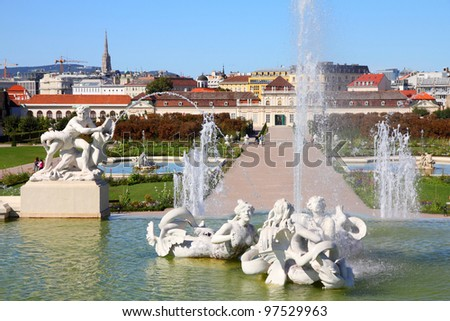 Castle Belvedere gardens in Vienna, Austria. Fountain statues. The Old Town is a UNESCO World Heritage Site. - stock photo