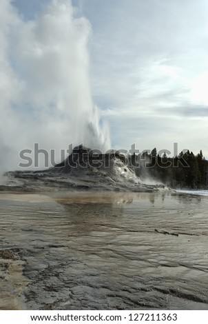 Castle Geyser Erupting, Yellowstone National Park, WY - stock photo