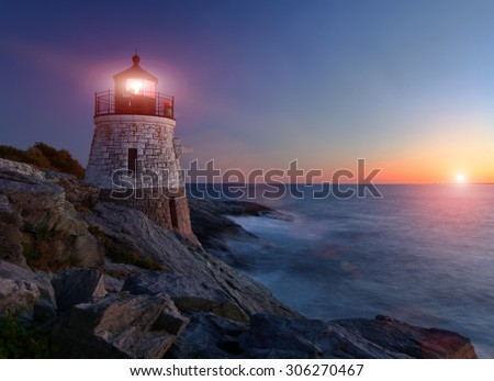 Castle Hill Lighthouse at sunset with setting sun - stock photo