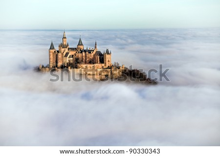 Castle Hohenzollern over the clouds - stock photo