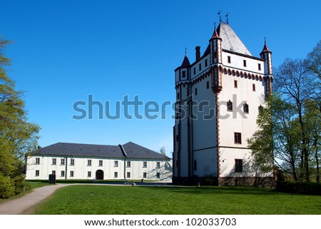Castle Hradec nad Moravici in Moravia Czech republic - view at water reservoir and chateau - stock photo