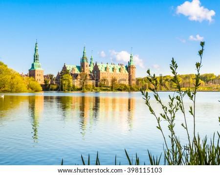 Castle Lake and Palace Frederiksborg Slot, Hillerod, Denmark - stock photo