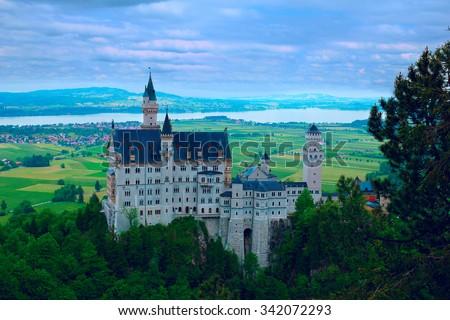Castle Neuschwanstein in Bavarian mountains - stock photo