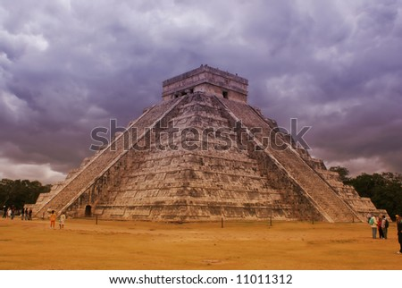 Castle of Kukulcan at the Chichen Itza, Mexico, on a cloudy day - stock photo