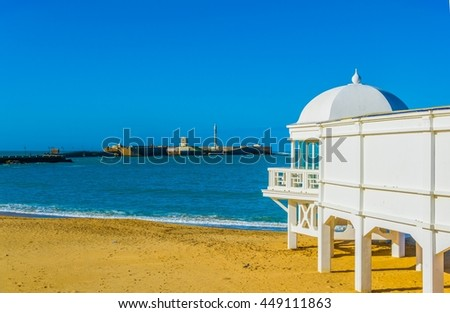 Castle of san sebastian in cadiz, spain viewed from the old bathhouse situated on la caleta beach - stock photo