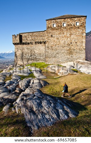 castle of Unterwalden by Bellinzona and running kid - stock photo