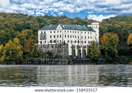 Castle Orlik under Orlik dam - stock photo