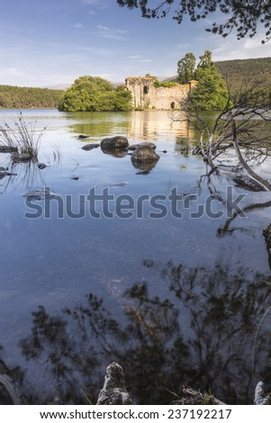 Castle Ruins on Loch an Eilein at Rothiemurchus in Strathspey & Badenoch in Scotland. - stock photo