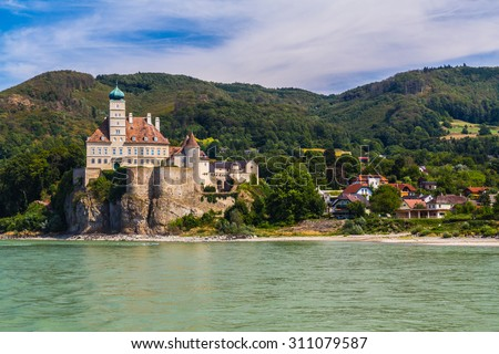 Castle Schoenbuehel along the Wachau Valley. Other buildings and hills can be seen.  - stock photo