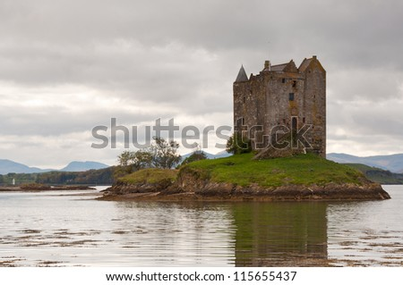 castle stalker in the scottish highlands on a dreary autumn day. - stock photo