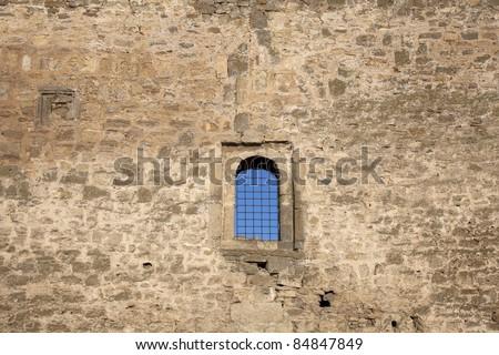 castle stone wall with a window, Akkerman, Belgorod-Dnestrovskiy, Ukraine - stock photo