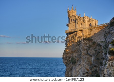 Castle Swallows Nest on the cliff near the sea with skyline - stock photo