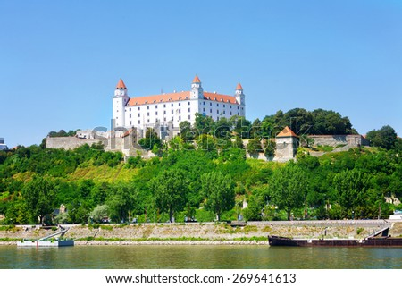 Castle the Bratislava grad on the hill over the Danube River - stock photo