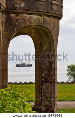 Castle vault with a ship in the bay - stock photo