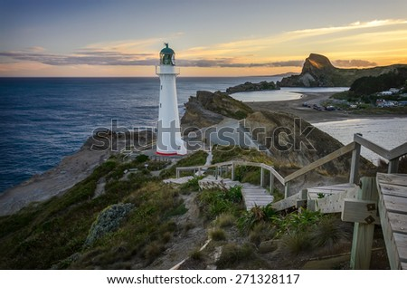 Castlepoint Lighthouse lookout over the small bay that fishing boats go out. New Zealand - stock photo