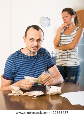 Casual adult american family having finacial problems and debts - stock photo