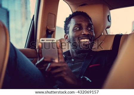 Casual afro american male in a car. - stock photo