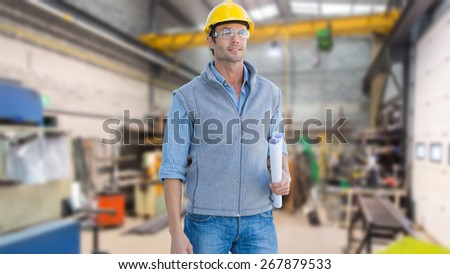 Casual architect against workshop - stock photo