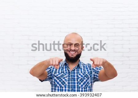 Casual Bearded Business Man Smiling Point Fingers At You Over White Brick Office Wall - stock photo