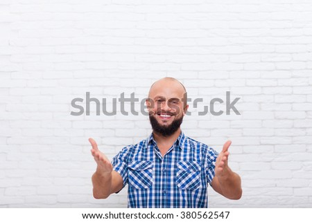Casual Bearded Business Man Smiling Welcome Hand Gesture At You Office White Brick Wall - stock photo