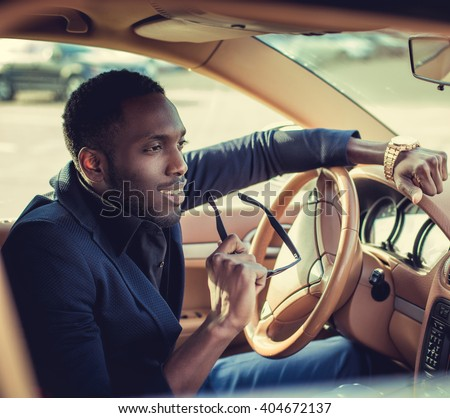 Casual black man in the car. - stock photo