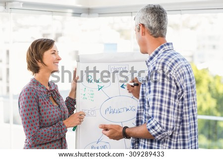 Casual business colleagues preparing presentation in the office - stock photo