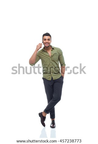 Casual business man happy smile young handsome guy cell smart phone speak full length wear shirt isolated white background - stock photo