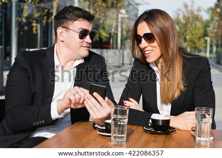 Casual business talk over coffee - stock photo