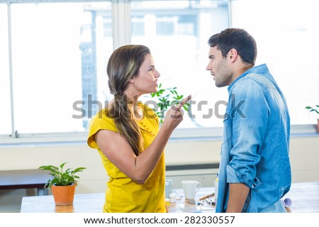 Casual business team having an argument in the office - stock photo