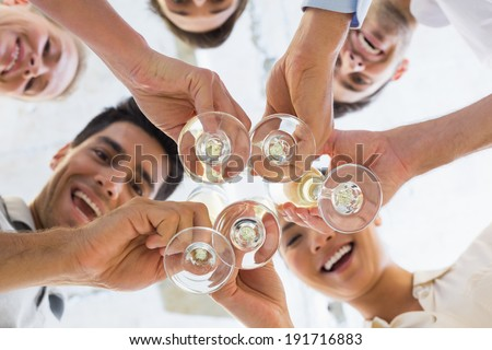 Casual business team toasting with champagne in the office - stock photo