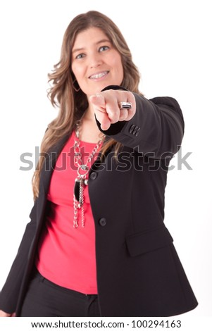 Casual business woman pointing at camera - stock photo
