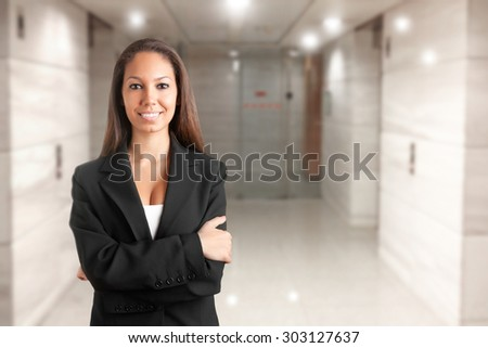 Casual business woman with arms crossed  - stock photo