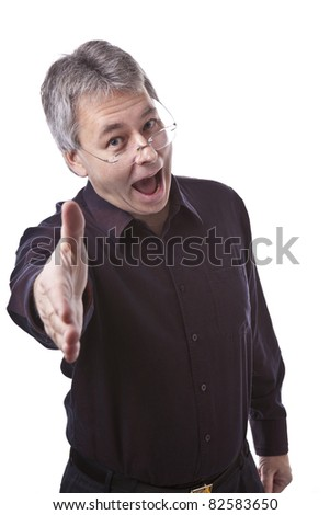 Casual businessman greeting handshake - stock photo