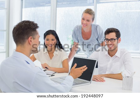 Casual businessman using laptop during meeting in the office - stock photo