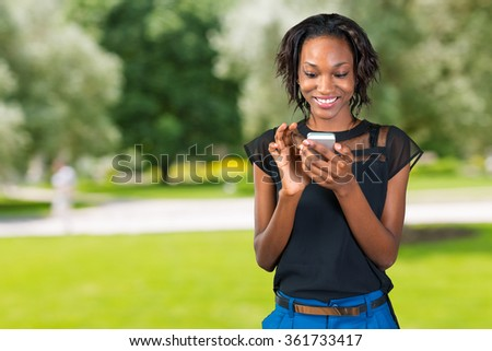Casual businesswoman texting on phone - stock photo