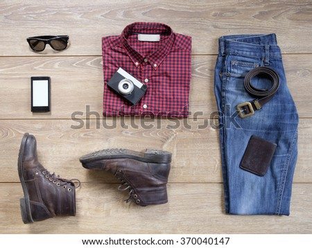 Casual clothing for men on wood - stock photo