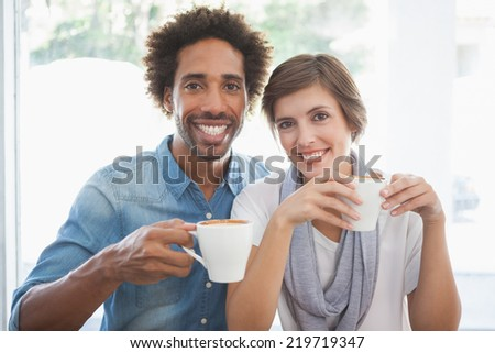 Casual couple having coffee together at the coffee shop - stock photo