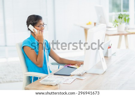 Casual designer working at her desk in the office - stock photo