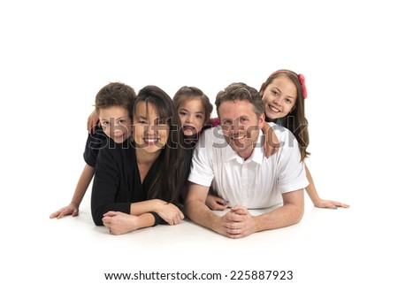 casual family / isolated on the white / lying on the floor - stock photo