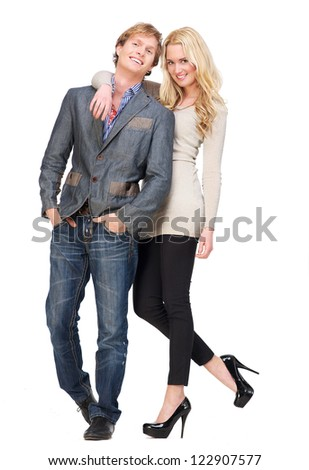 Casual guy and beautiful girl isolated on white background. Full length portrait of a friendly couple being happy together. - stock photo