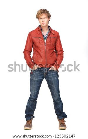 Casual guy standing with hands in jeans pocket. Isolated on white background - stock photo