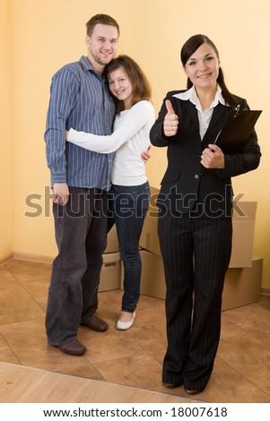 casual happy couple making transaction - stock photo