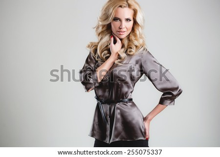 Casual. High fashion. Emotional portrait of a beautiful sexy blonde with long hair and bright make-up. Beautiful lady posing. Young fashion woman. fashionable woman - stock photo