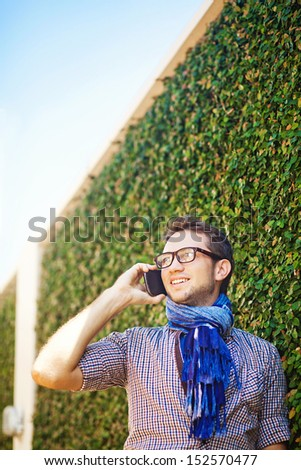 casual man in the city calling by phone - stock photo