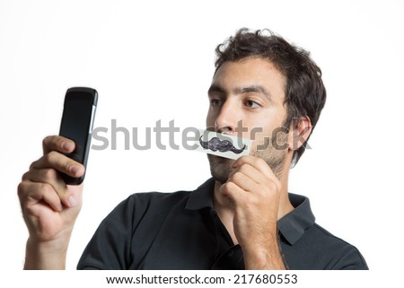 casual man make selfie portrait with fake moustache,  close composition isolated - stock photo