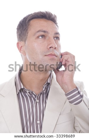 casual man on a mobile phone isolated over a white background - stock photo