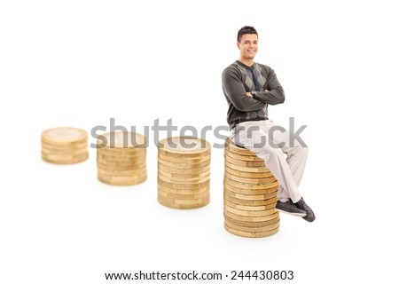 Casual man sitting on a pile of coins isolated on white background - stock photo
