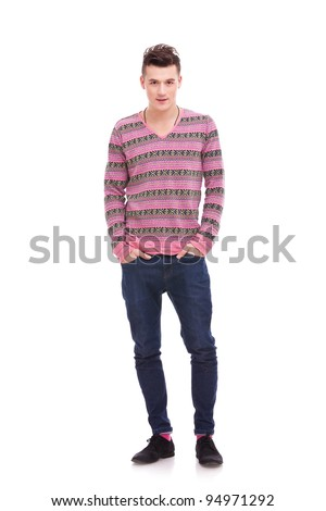 casual man standing isolated over a white background . full body picture of a young man with his hands in his pockets - stock photo