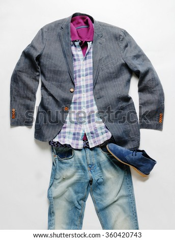 casual men clothes in a shape of a man in plan  - stock photo